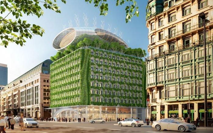 Das Botanic Center genannte Apartmenthaus in Brüssel passt vom Aussehen bisher so gar nicht zu seinem Namen. Bisher war es nämlich ein trauriger, grauer Betonklotz. Doch das soll sich ändern. Das Architekturbüro Vincent Callebaut will den grauen Kasten ein lebendiges Gebäude verwandeln. Wie eine Blume soll es aufblühen, endlich im 21. Jahrhundert ankommen und ein neues Wahrzeichen der belgischen Hauptstadt werden. Dazu soll es rundherum komplett begrünt werden und sich durch erneuerbare Energien zumindest teilweise selbst versorgen. Bild: © VINCENT CALLEBAUT ARCHITECTURES